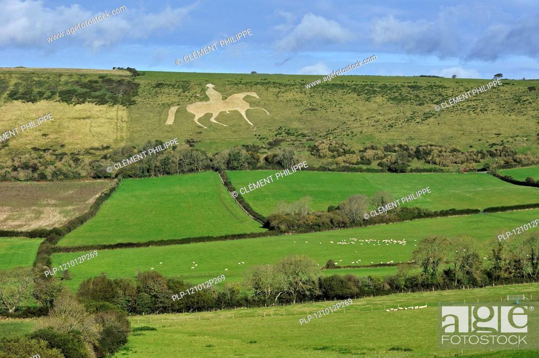 Stock Photo: The Osmington White Horse, hill figure of George III on horseback sculpted in 1808 into the limestone Osmington hill along the Jurassic Coast, Dorset.
