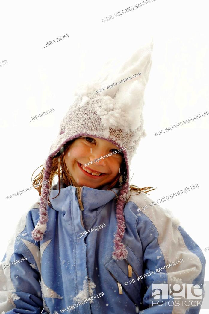 Stock Photo: Girl playing in the snow, fun in winter.