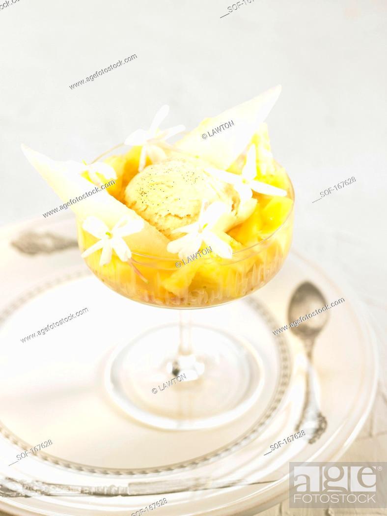 Stock Photo: Vanilla ice cream,pineapple,melon and jasmin flower dessert.
