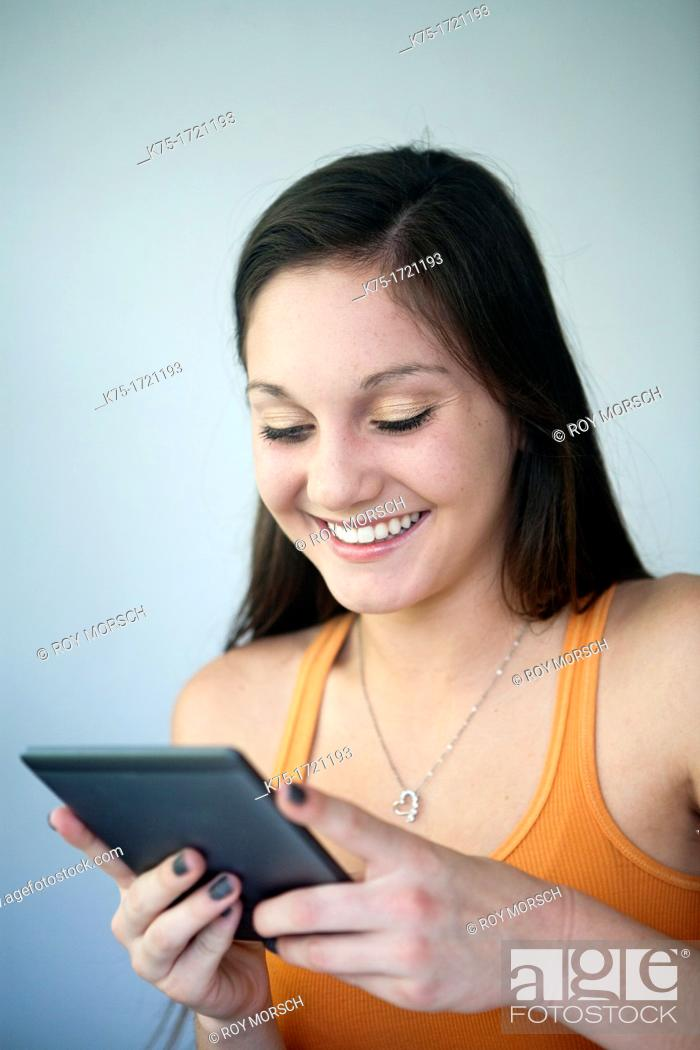 Stock Photo: Reading on e-book tablet.