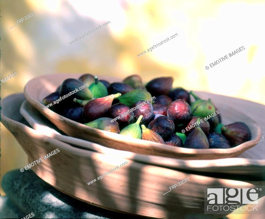 Stock Photo: Figs in a wooden bowl.