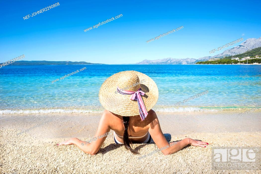 Stock Photo: Woman relaxing on beach.