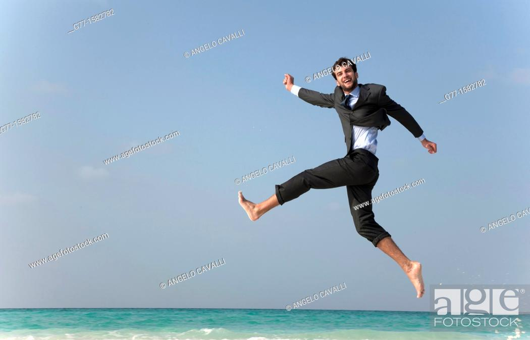 Stock Photo: Maldives Islands Ari Atoll Business man jumping on the beach.