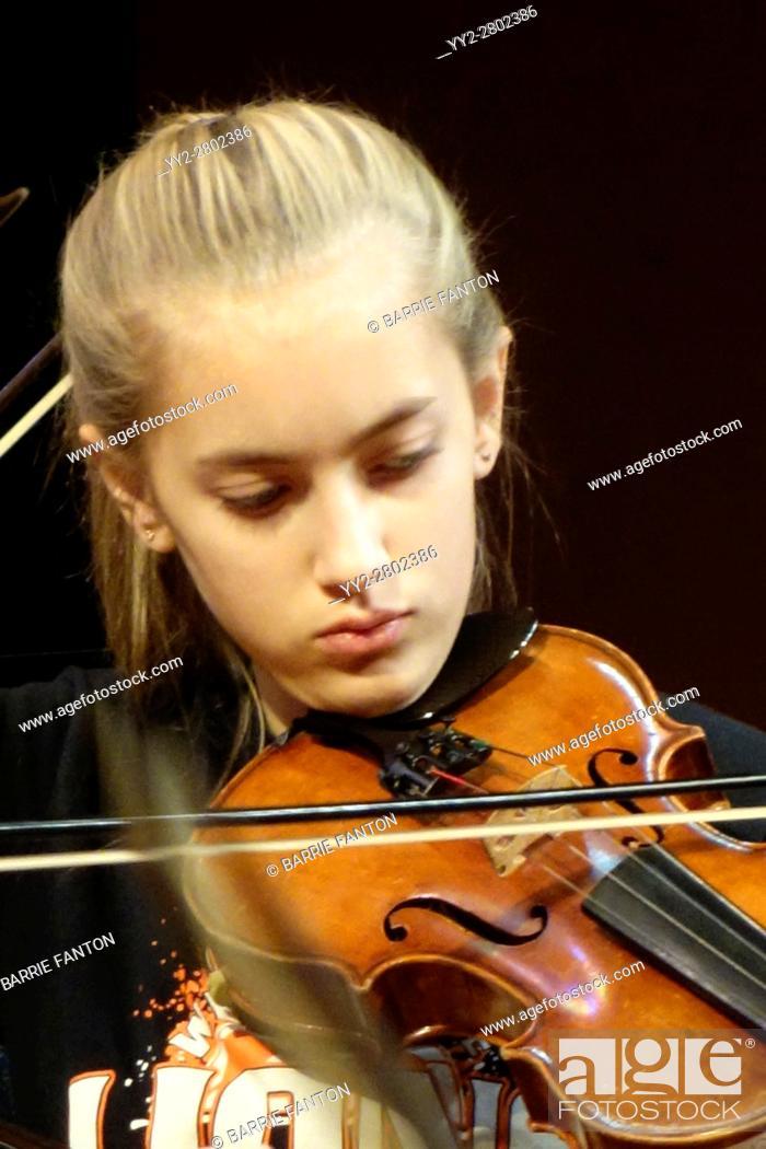 Stock Photo: 8th Grade Girl Playing Violin, Wellsville, New York, USA.
