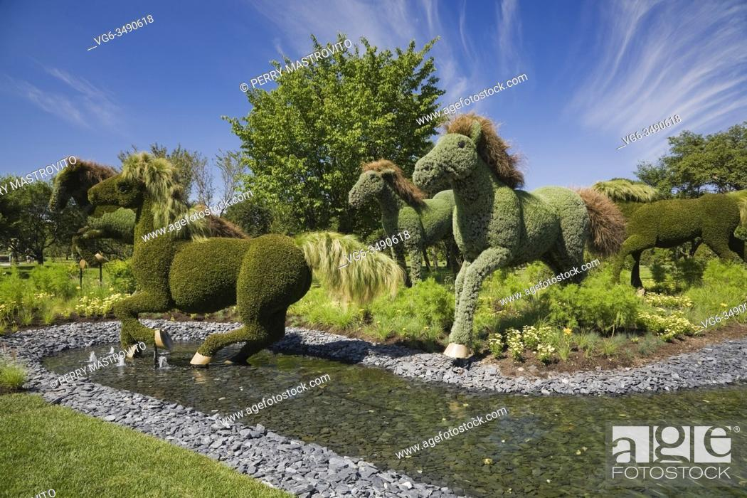 Stock Photo: Living plant galloping horse sculptures belonging to the exhibit called 'Mother Earth' created on metal mesh forms filled with earth and planted with various.