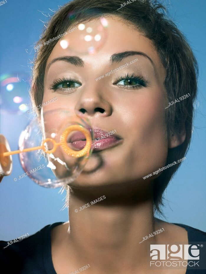 Stock Photo: Woman blowing bubbles.
