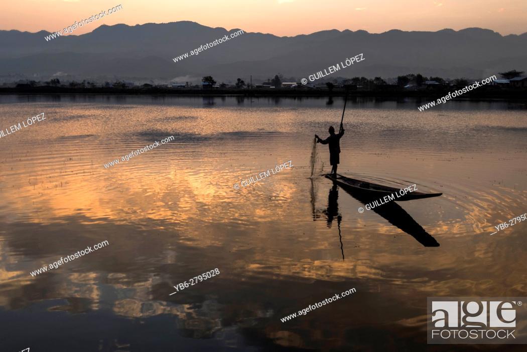 Stock Photo: Fisherman working at the Tharzi Pond in Nyaungshwe, Myanmar.