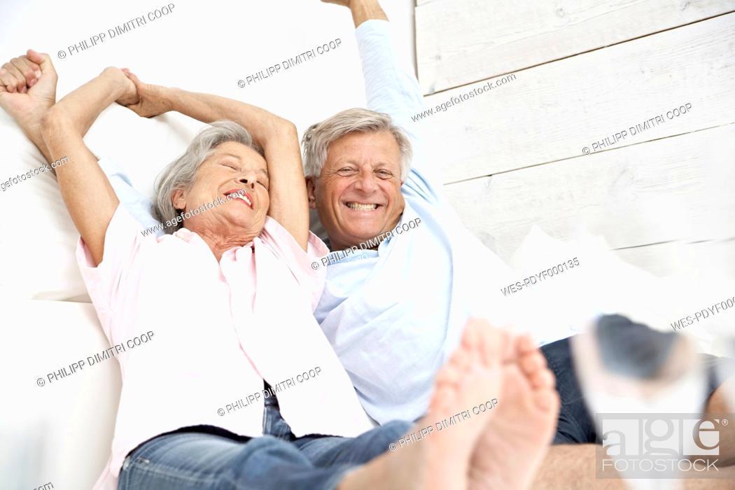 Stock Photo: Spain, Senior couple waking up, smiling.