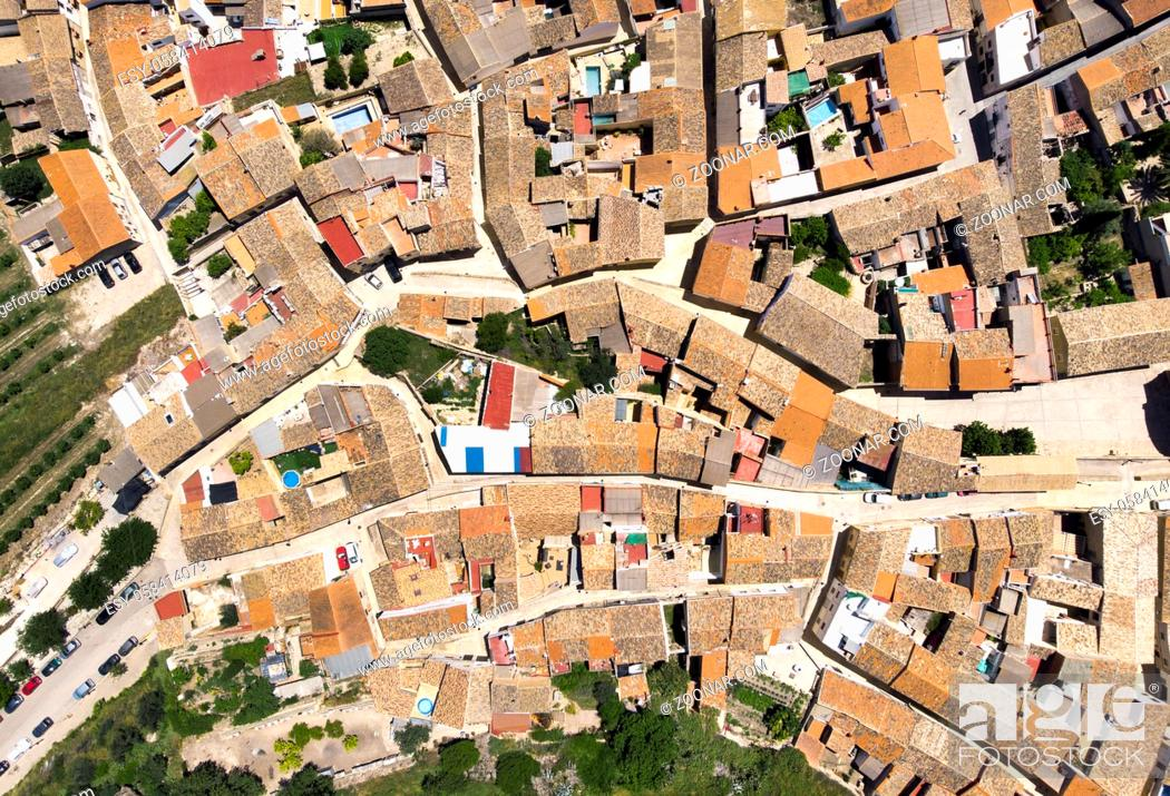 Stock Photo: Directly from above view ancient houses rooftops and roads, view from top. Montesa village. Spain.
