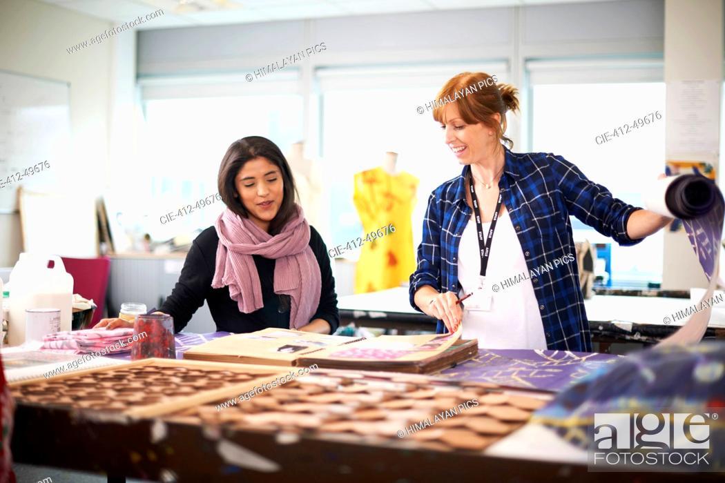 Stock Photo: Female fashion designers working in studio.