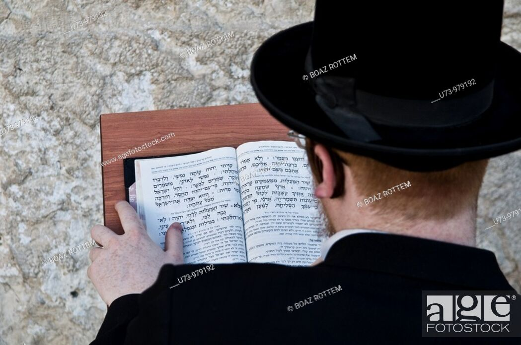 Stock Photo: An Orthodox Jewish man praying by the wailing wall in the old city of Jerusalem, Israel.