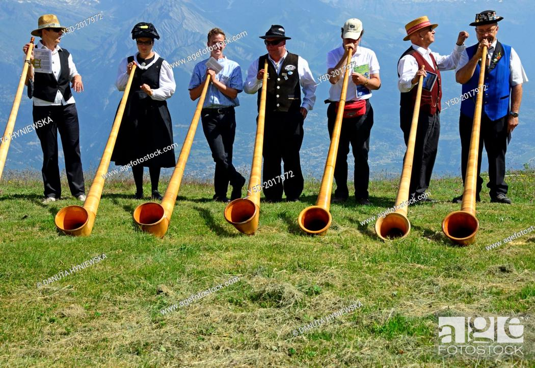 Stock Photo: alphorn players, Nendaz, Valais, Switzerland.