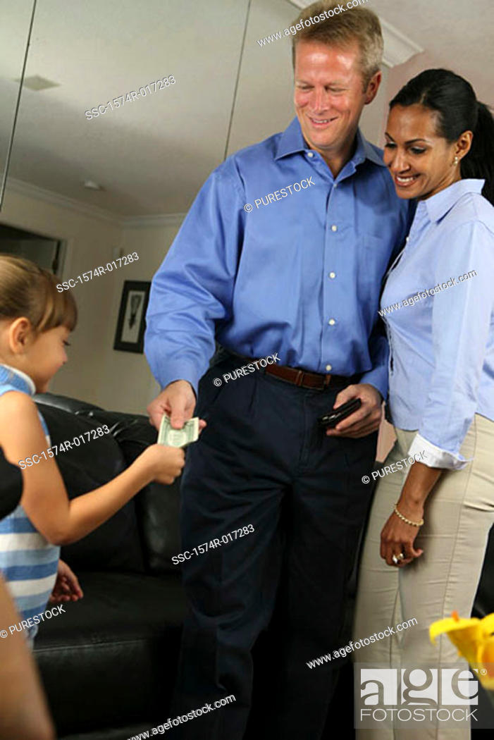 Stock Photo: Low angle view of parents giving money to their daughter.