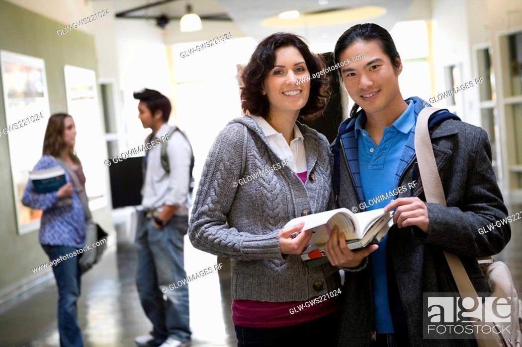 Stock Photo: University students standing in a corridor.