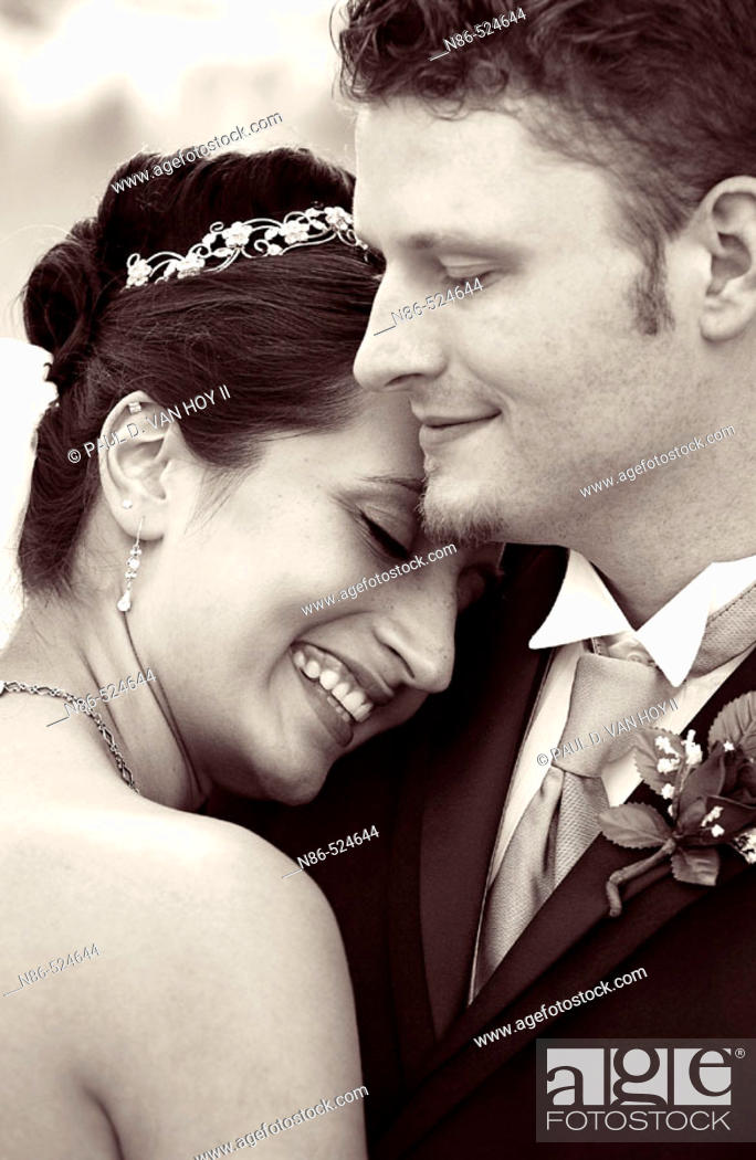 Stock Photo: Bride and groom hugging.
