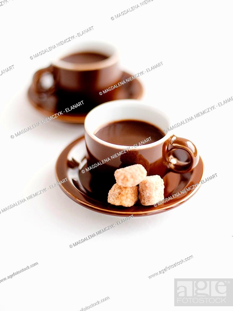 Stock Photo: Fresh coffee in cups with brown sugar lumps.