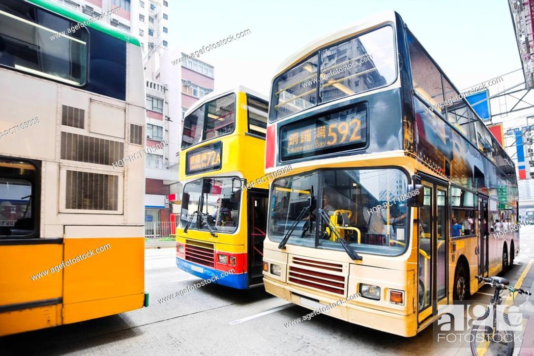 Stock Photo: Buses on the road, Hong Kong Island, Hong Kong, China.