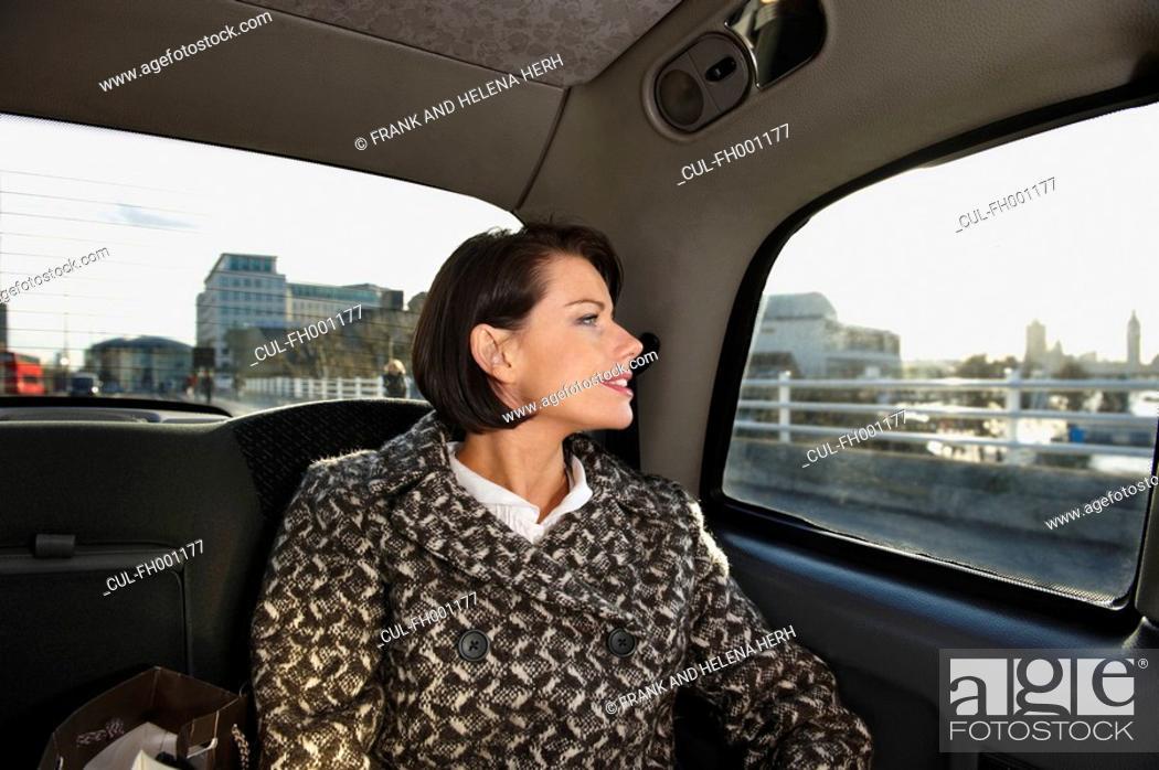 Stock Photo: Woman in London taxi.
