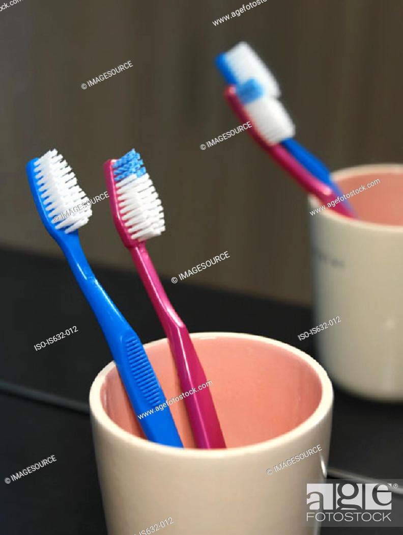 Stock Photo: Toothbrushes in mug.