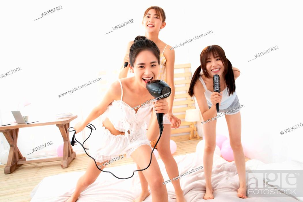 Stock Photo: Friends play in the bedroom.
