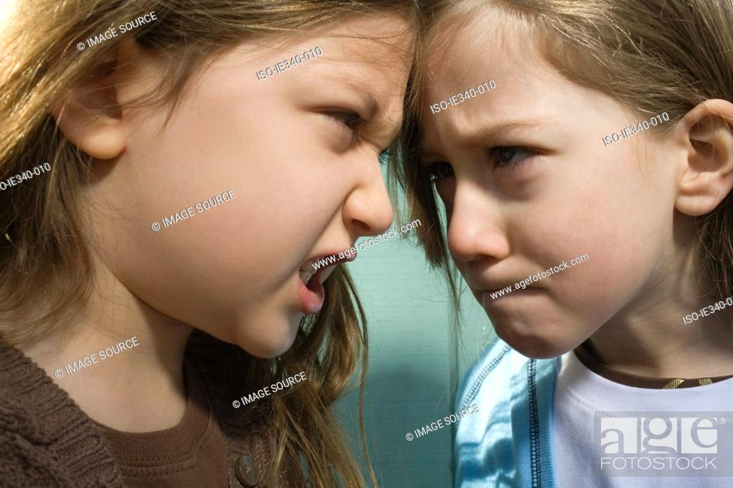 Stock Photo: Sisters fighting.