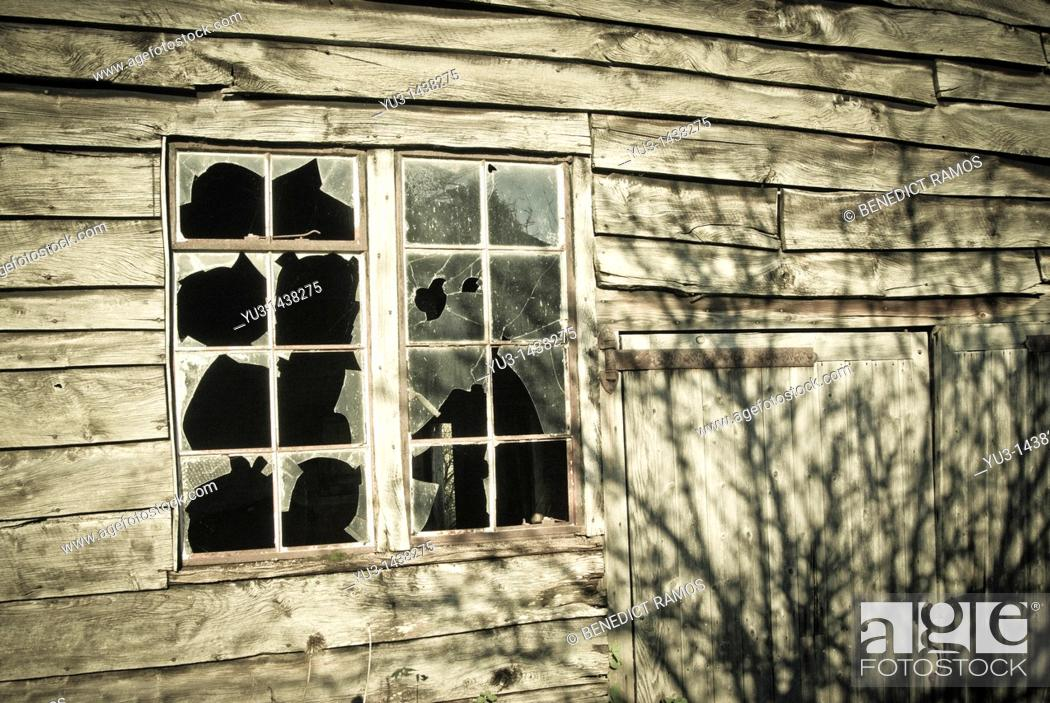 Stock Photo: Broken window panes on wooden outbuilding.