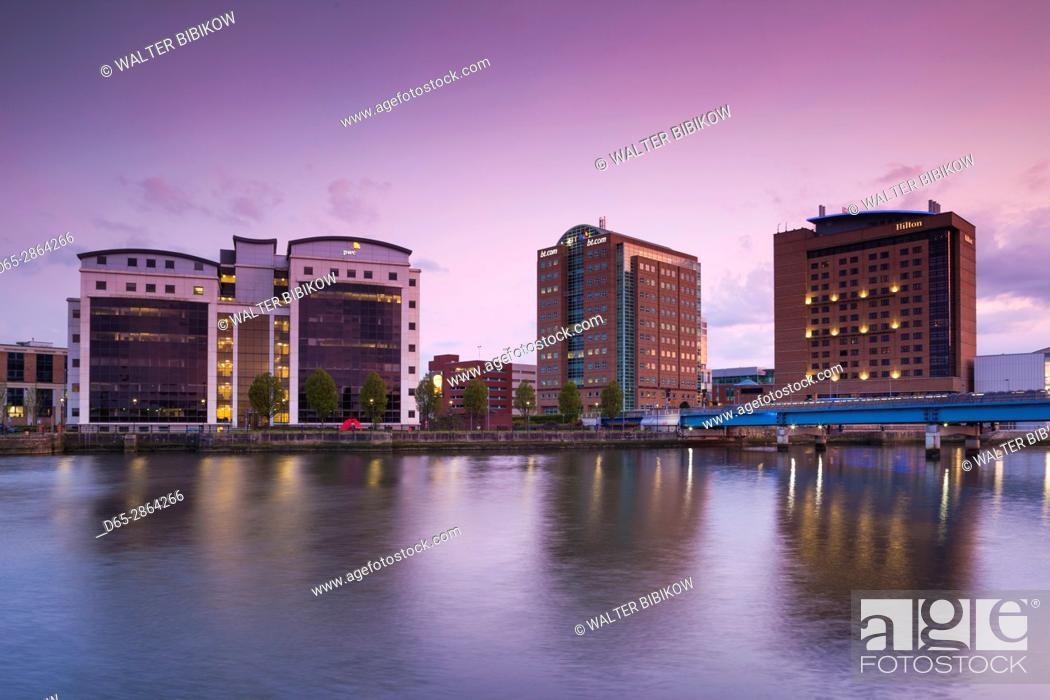 Stock Photo: UK, Northern Ireland, Belfast, city skyline along River Lagan, dusk.