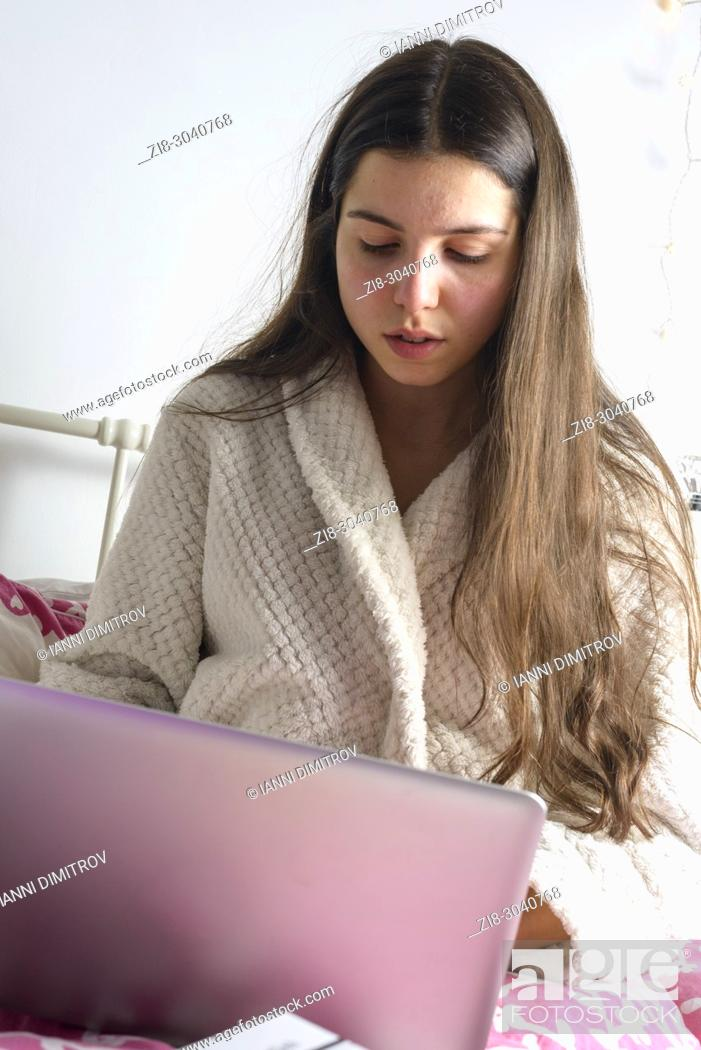 Stock Photo: Teenage Schoolgirl, 16 years old studies in bed, Surrey, UK.