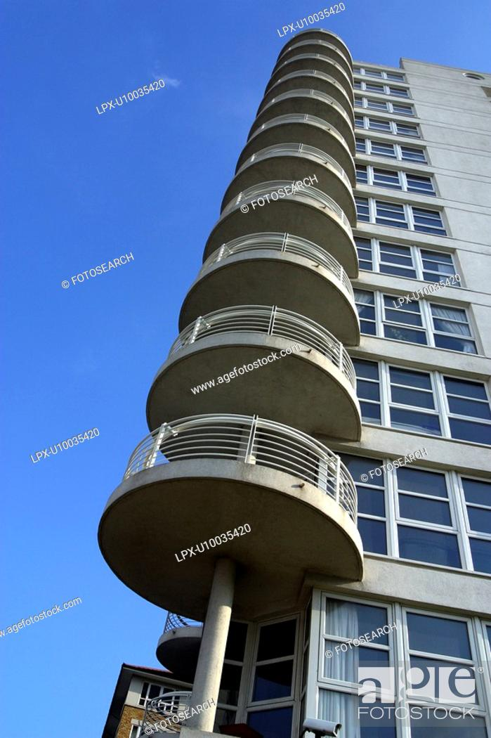 Stock Photo: Round shaped balconies on the edge of a residential building,.