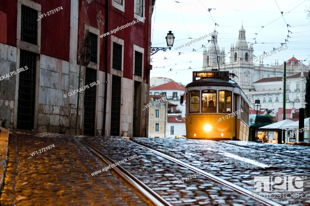 Stock Photo: Romantic atmosphere in the old streets of Alfama with the castle in the background and tram number 28 Lisbon Portugal Europe.