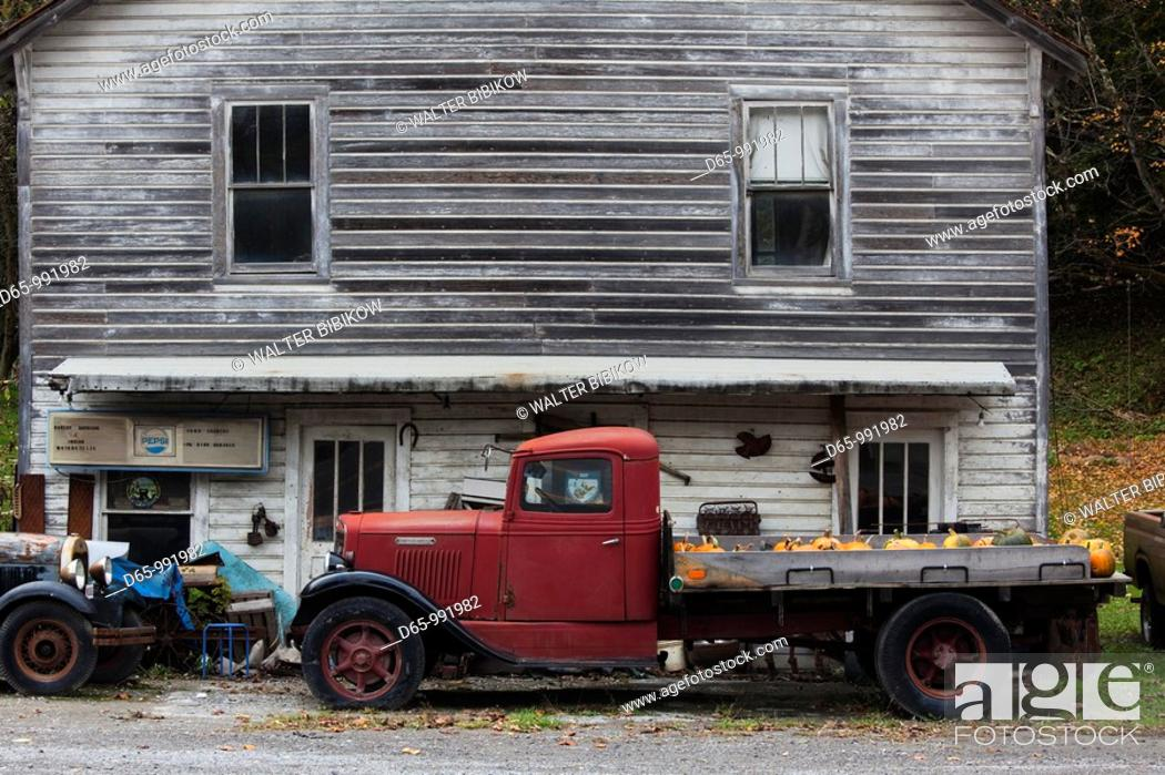 Stock Photo: USA, West Virginia, Bluewell, National Coal Heritage Area, 1930s-era truck with pumpkins, autumn.