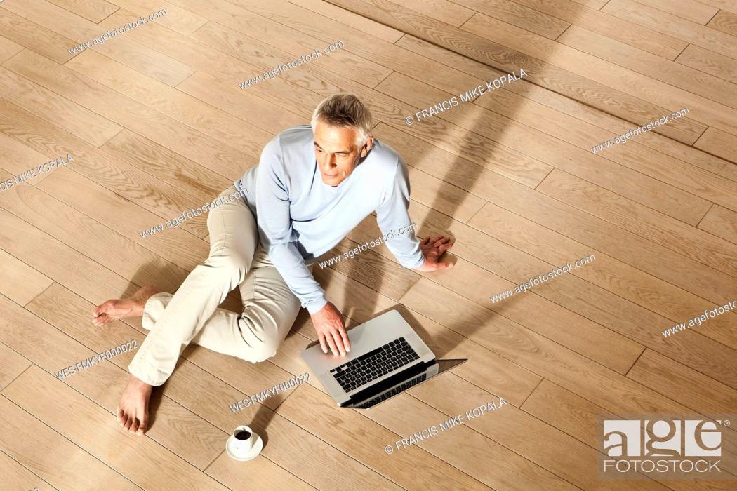 Stock Photo: Germany, Berlin, Senior man using laptop.