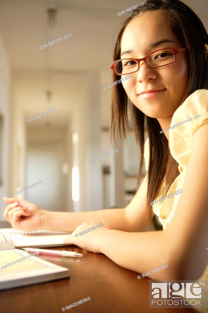 Stock Photo: Teenage girl 14-15 wearing glasses, portrait.