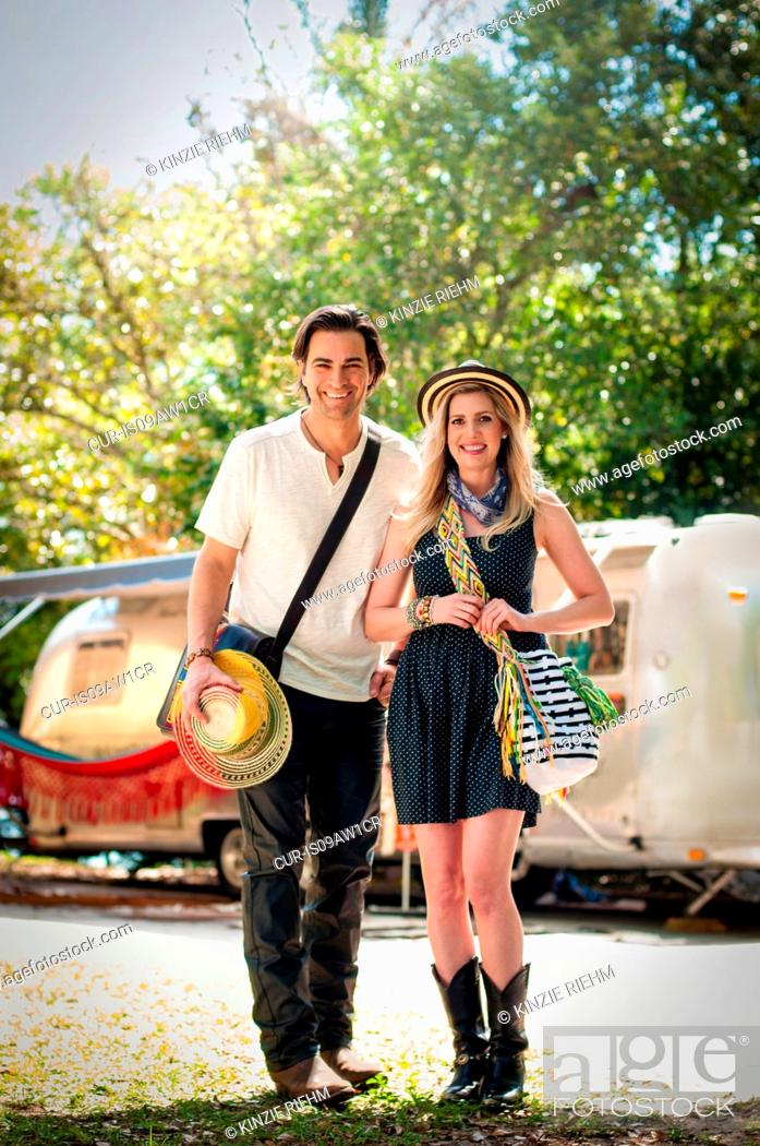 Stock Photo: Portrait of couple in front of converted boutique airstream trailer.