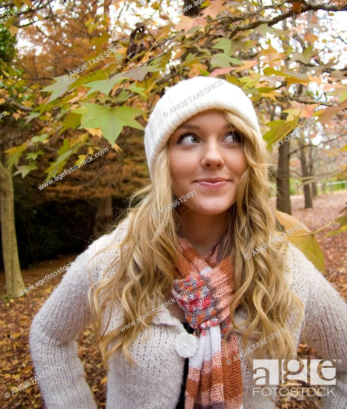 Stock Photo: pretty girl in the park during autumn.