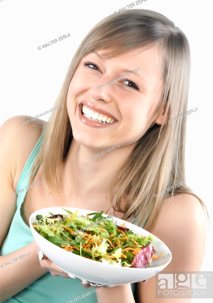 Stock Photo: Portrait of young happy woman eating salad.