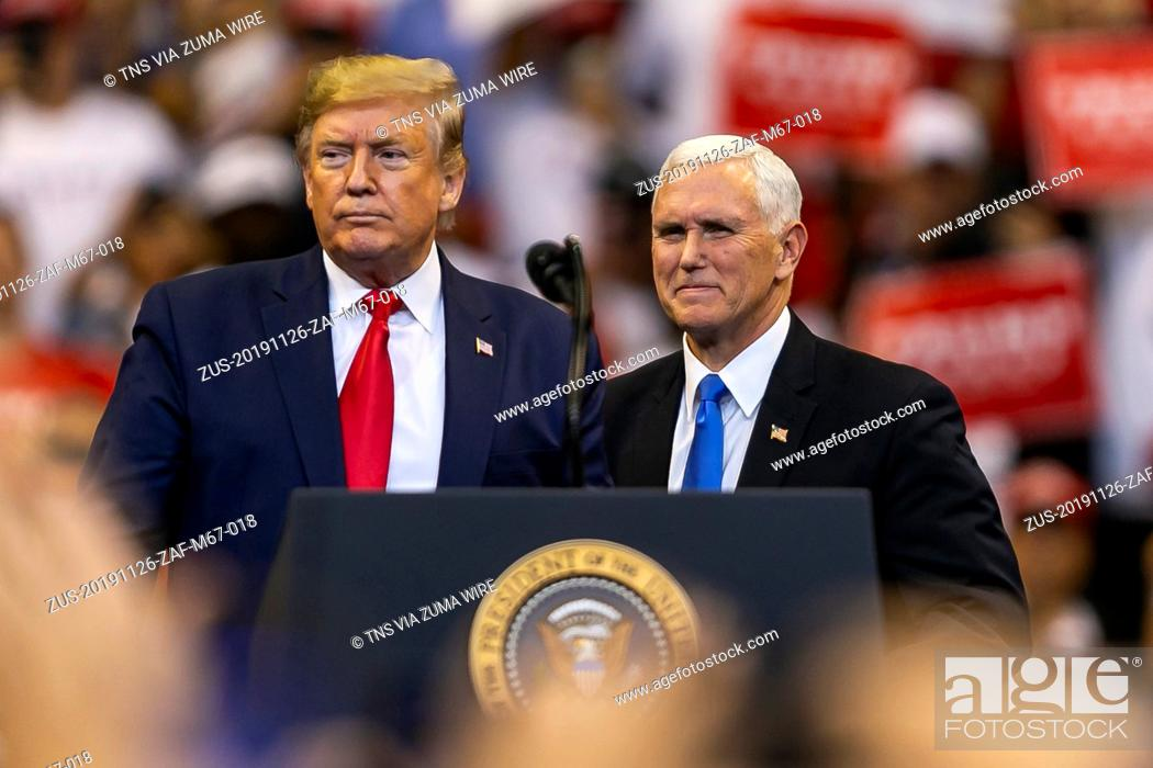 Stock Photo: November 26, 2019, Sunrise, FL, USA: President Donald Trump, left, and Vice President Mike Pence attend a 'homecoming' rally at the BBT Center in Sunrise, Fla.