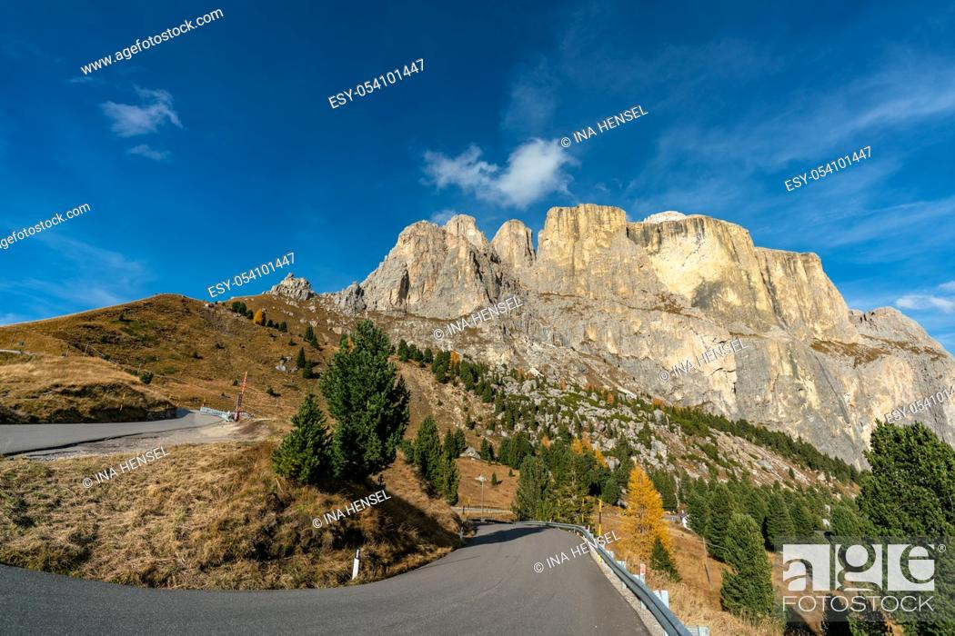 Stock Photo: The winding road through the beautiful landscape at the Sella mountains pass in South Tyrol, Italy on a sunny autumn day.