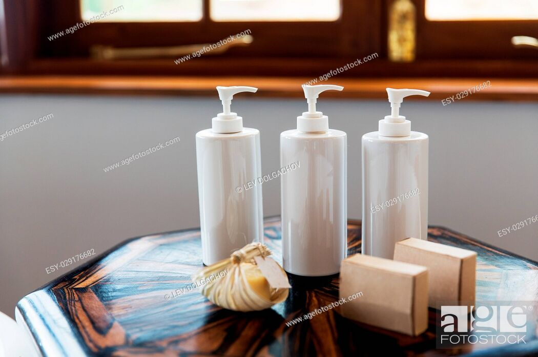 Stock Photo: beauty, spa, luxury and bodycare concept - set of bottles with liquid soap or body lotion set at hotel spa bathroom.