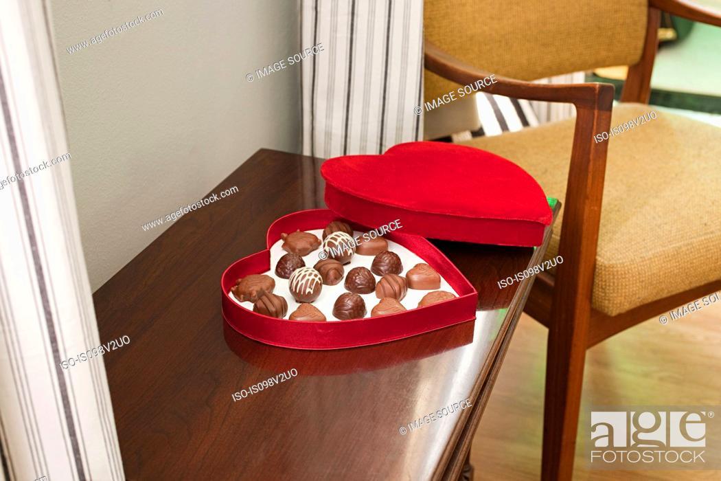 Stock Photo: Chocolates in heart shaped box.