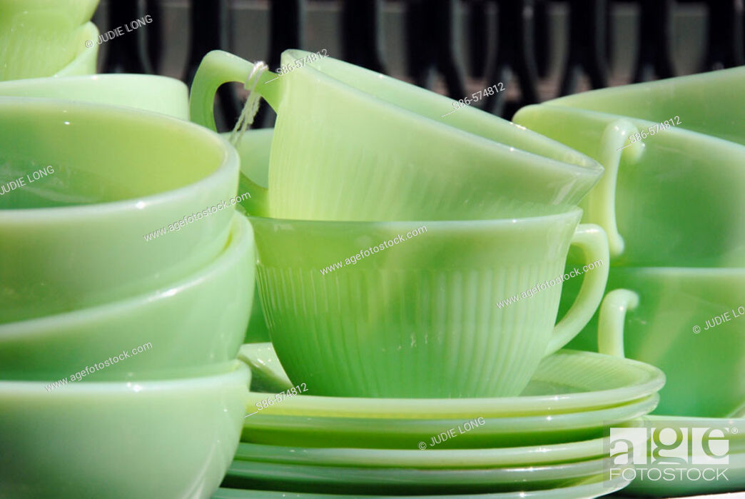 Stock Photo: 1950's Vintage Green Glass Dishes displayed at an outdoor flea market.
