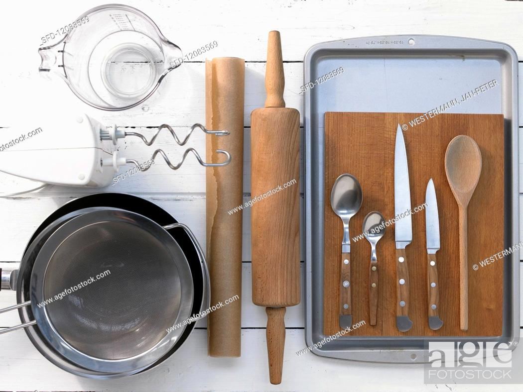Stock Photo: Assorted kitchen utensils for preparing traybakes.