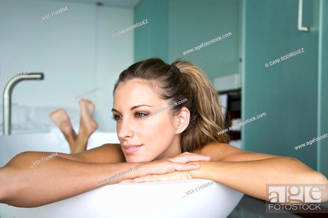 Stock Photo: Blonde and beautiful woman enjoying a bath at home.