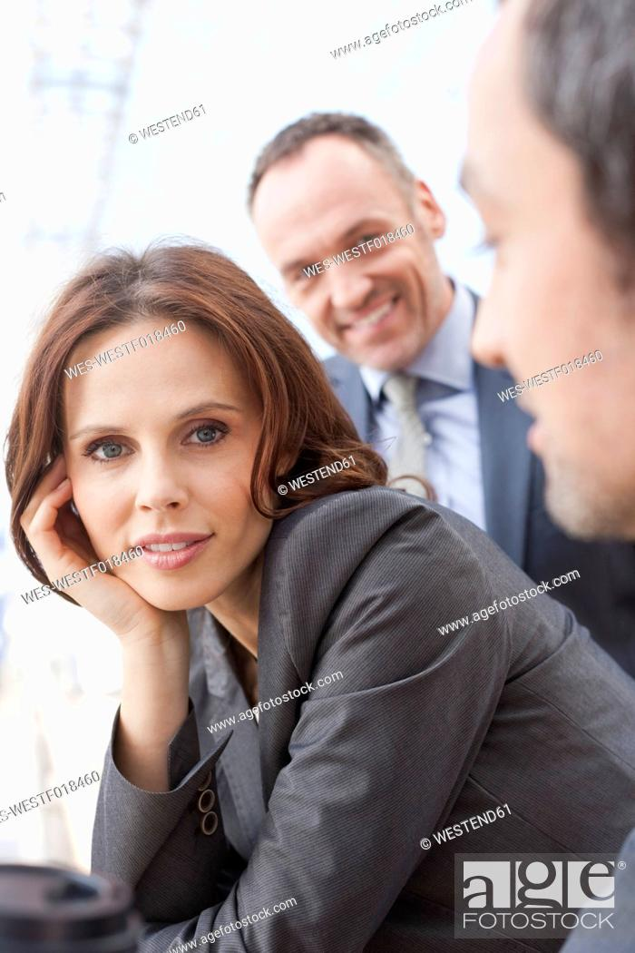 Stock Photo: Germany, Leipzig, Business people, smiling.