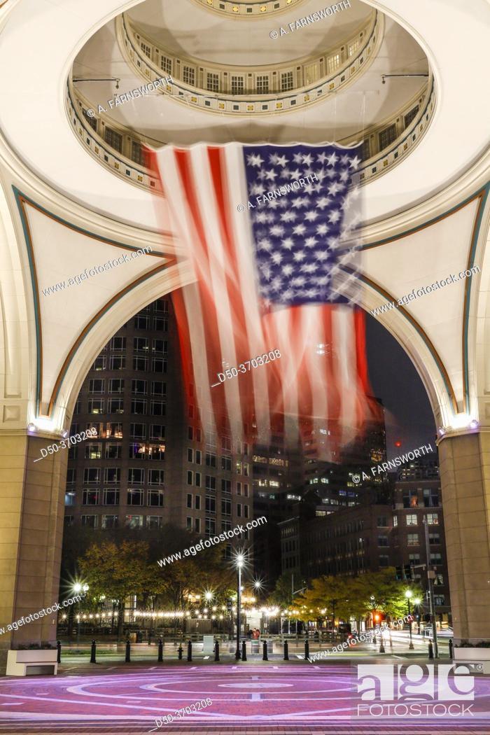 Stock Photo: Boston, Massachusetts, USA A large American flag hangs in the rotunda at the harborwalk.