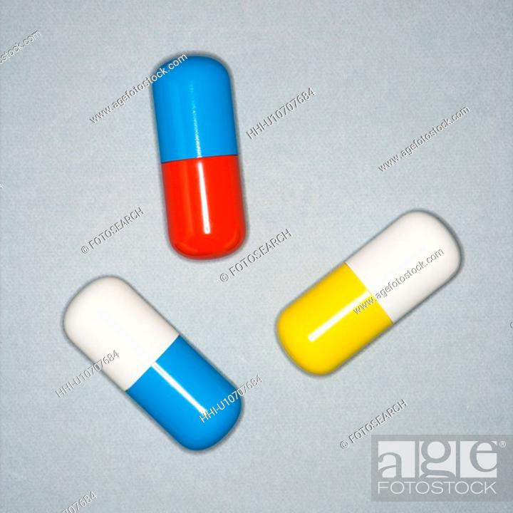 Stock Photo: Medical pills on a gray background.