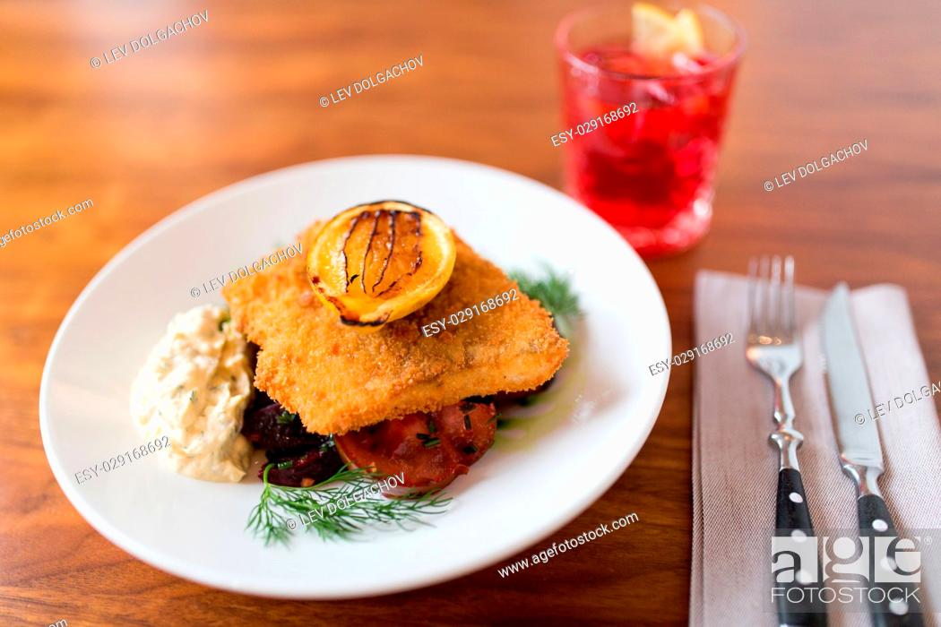 Photo de stock: food, new nordic cuisine, dinner, culinary and cooking concept - close up of breaded fish fillet with tartar sauce and oven-baked beetroot tomato salad on plate.