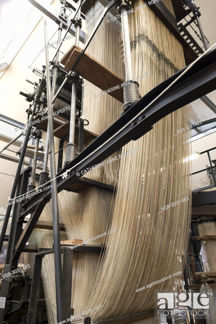Stock Photo: Epic cascades of thread, resembling a galleon ship in full sail, supported by wood and metal architecture of industrial revolution jacquard textile industry.