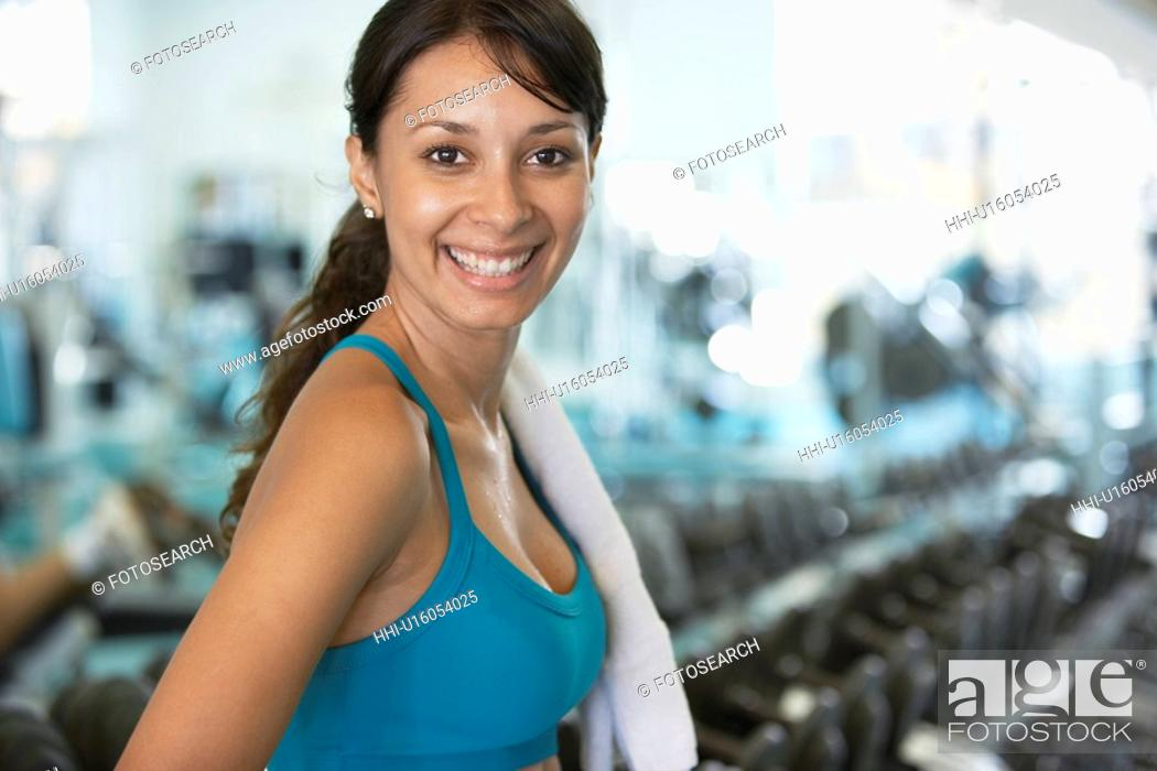 Stock Photo: Young woman in gym (portrait).
