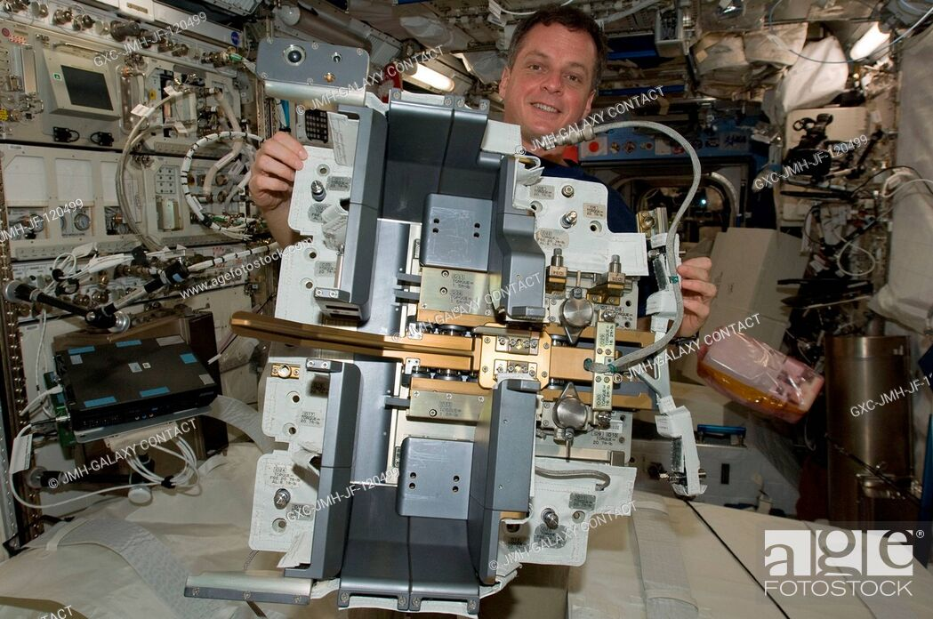 Stock Photo: NASA astronaut T.J. Creamer, Expedition 22 flight engineer, works with the Japanese Experiment Module Remote Manipulator System (JEMRMS) Small Fine Arm (SFA) in.